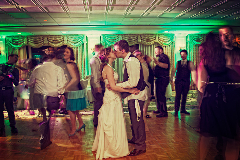married couple dancing and kissing